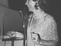 Birthday Girl speaking on the Microphone