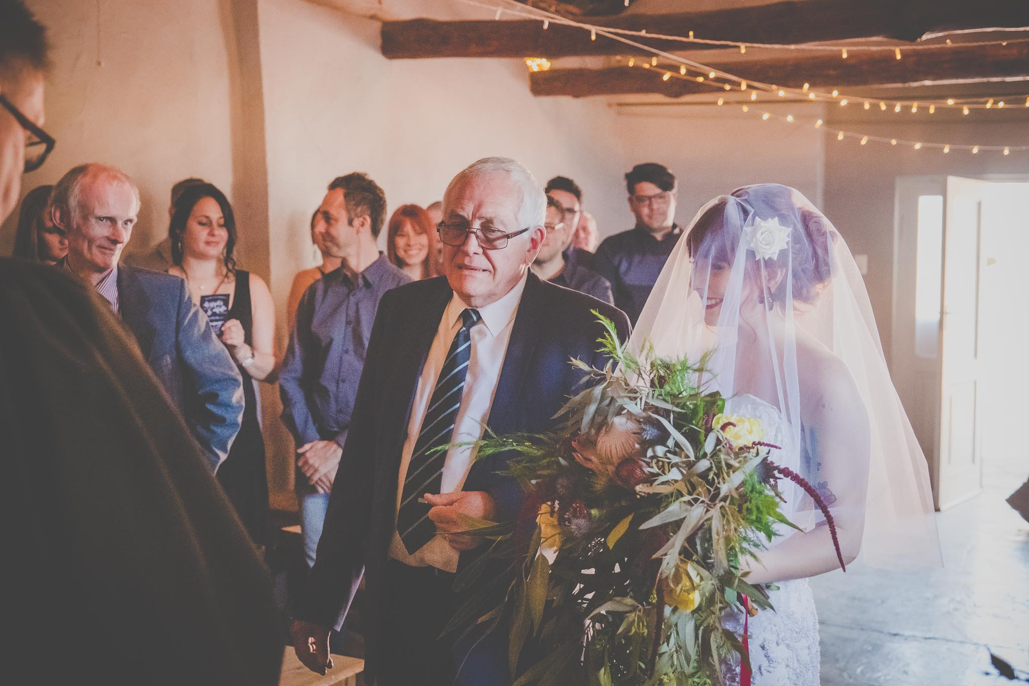 bride walking with father down the isle