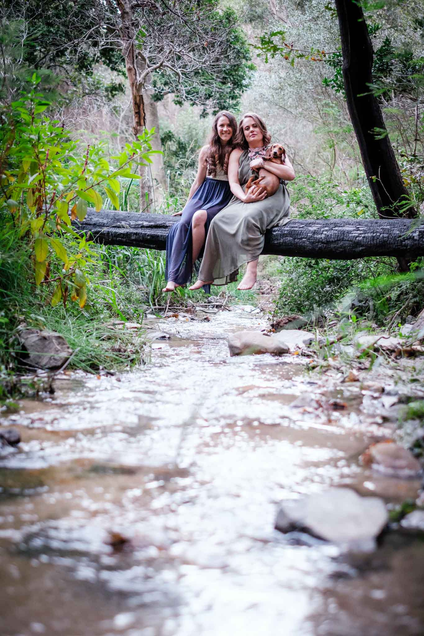 Couple over a stream