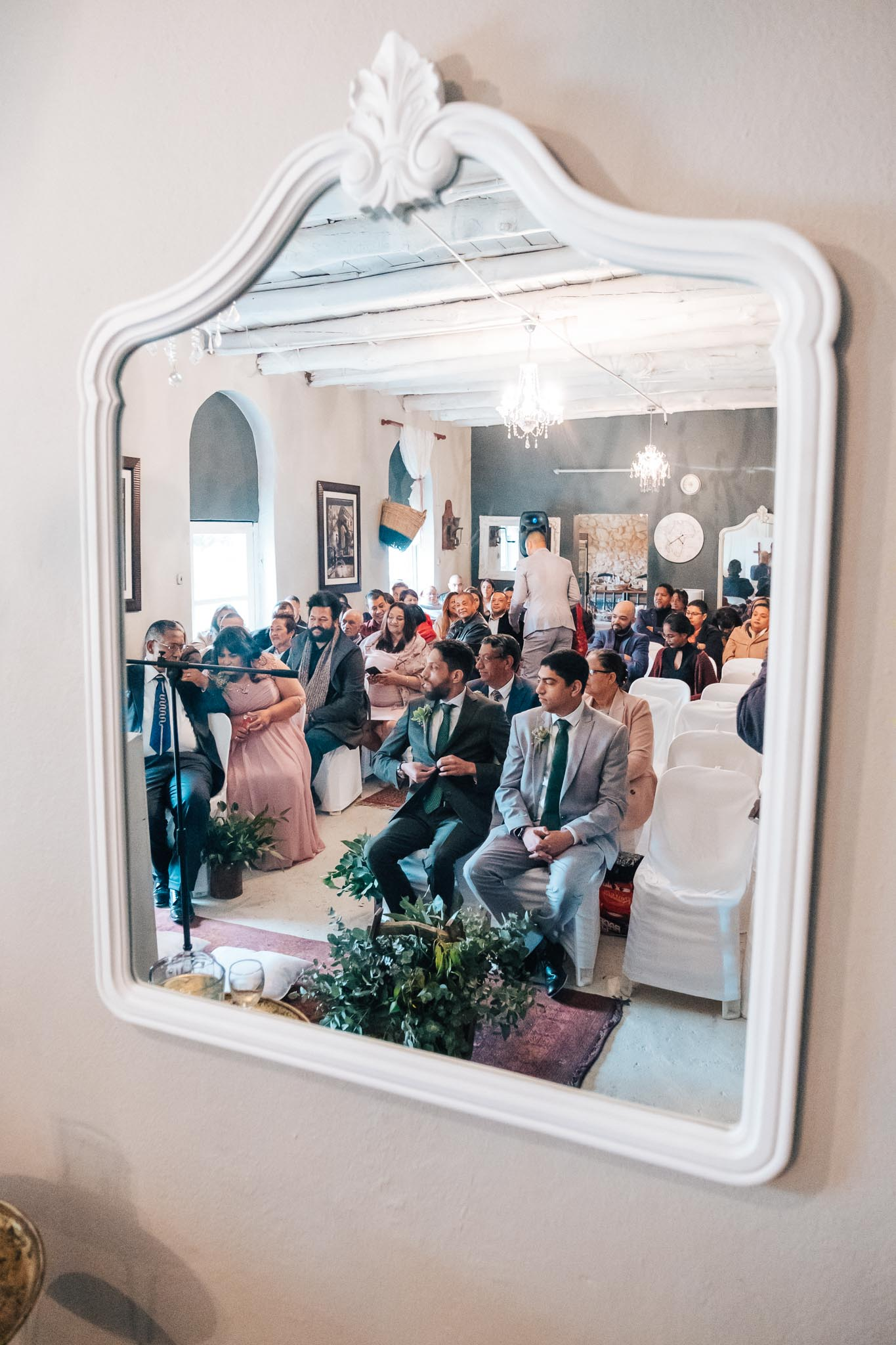 Ceremony reflected in a mirror