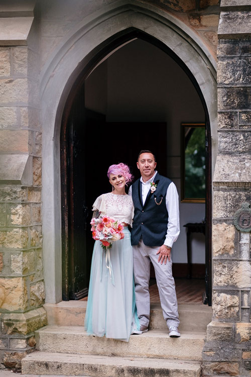 Wedding couple standing in the arch of the chapel at Monkey Valley Venue in Noordhoek.