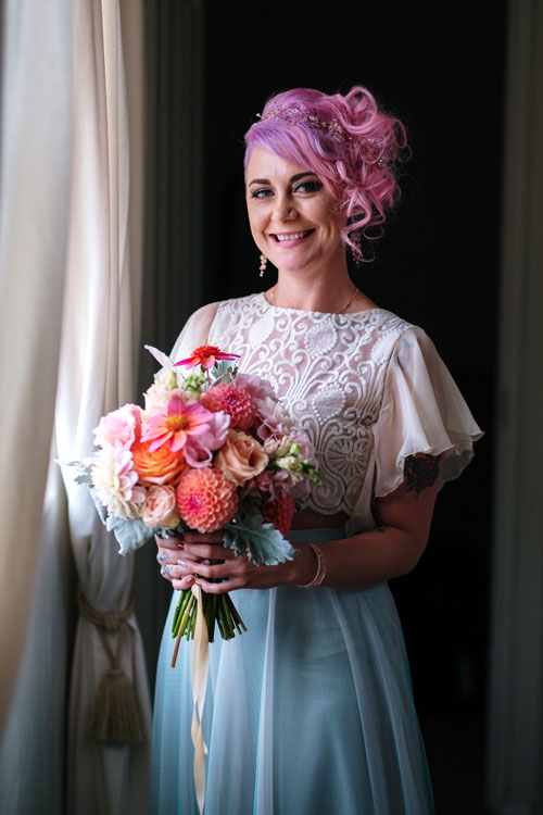 Ros, the bride, with her colourful wedding bouquet