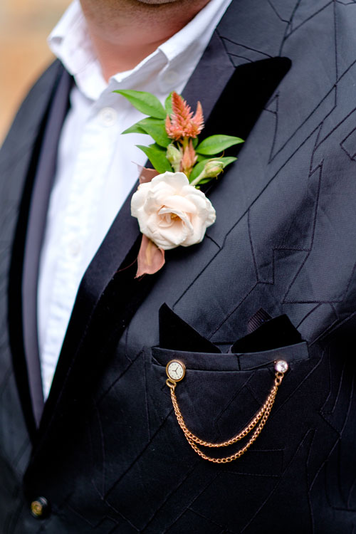 A close up shot of the Groom's suit and Boutonniere