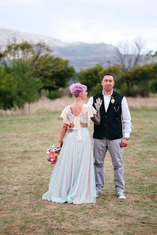 Bride and Groom posing together in the garden of Monkey Valley Venue
