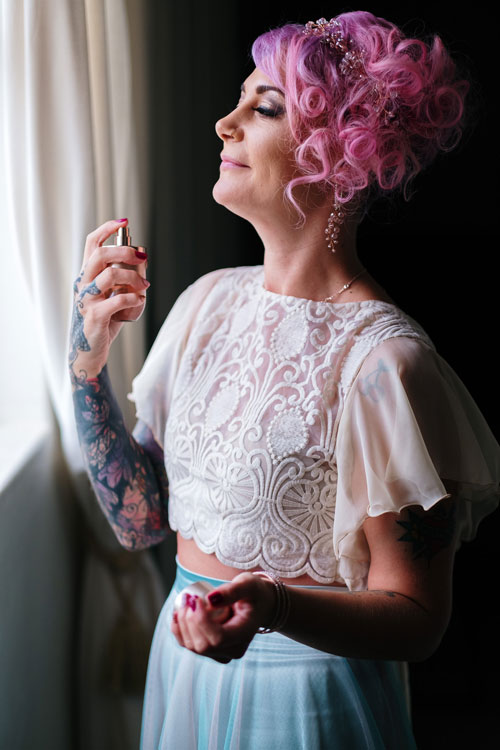 Ros being photographed for her wedding - putting on perfume